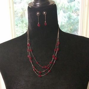Red and silver fashion jewelry set.